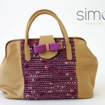 Beige and purple woven bag with bow