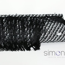 Black and white woven clutch with fringe