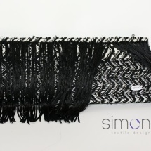Black, white and silver woven clutch with fringe