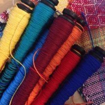 Colorful spools ready for weaving