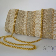 Gold woven clutch with chain