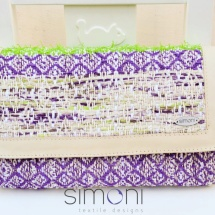 Green, purple and beige woven clutch