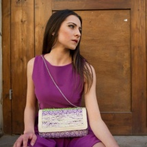 Green white and purple woven clutch