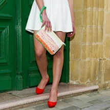 Orange green and white clutch