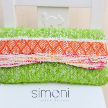 Orange green and white woven clutch