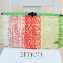 Orange green and white woven clutch with clip