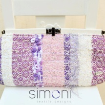 Pastel woven clutch with clip