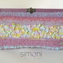 Pink woven clutch