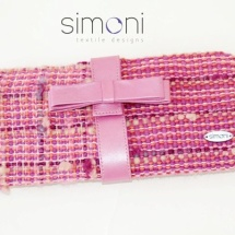 Pink woven clutch bag