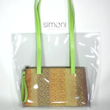 Plastic bag wirh woven purse and green handles