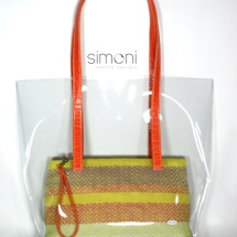 Plastic bag with woven purse and orange handles