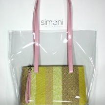 Plastic bag with woven purse and pink handle