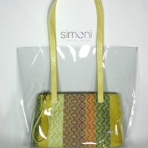 Plastic bag with woven purse and yellow handles