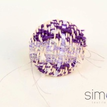 Purple and white woven ring