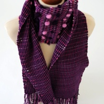 Purple scarf with pom poms