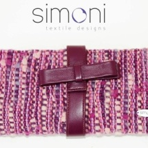 Purple woven clutch with bow