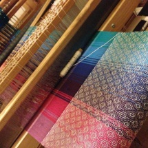Rainbow fabric with patterns on the loom
