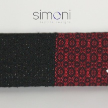 Red and black woven clutch
