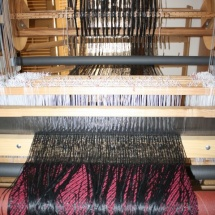 Weaving a fringed fabric