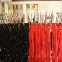 Weaving process: Black and red fabric