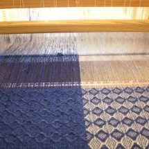 Weaving process: Blue and silver fabric
