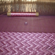 Weaving process :Purple and pink gliterry fabric