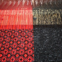 Weaving progress: final pieces in red and black