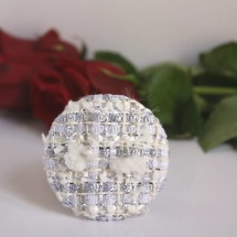 White and silver brooch