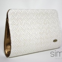 White clutch with gold leather