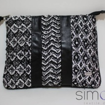 Woven black and white zip clutch