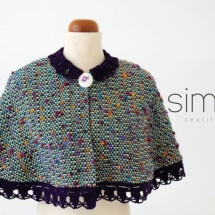 Woven cape with crochet lace