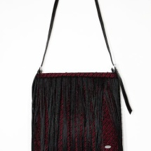 Woven fringed shoulder bag in red and black