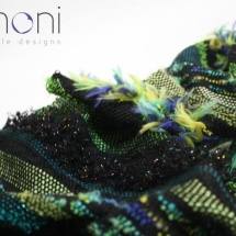 Woven green and black shawl : detail