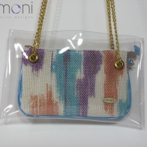 Woven hand dyed mini purse in plastic bag with blue handles