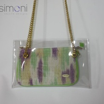 Woven hand dyed mini purse in plastic bag with green handles