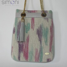Woven hand dyed shoulder bag with tussle