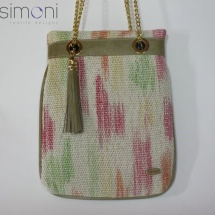 Woven hand dyed shoulder bag with tussle and beige leather