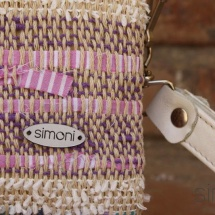 Woven, handmade purse with beige leather handle detail