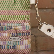 Woven, handmade purse with leather handle details