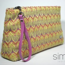 Woven purse with fucsia handles
