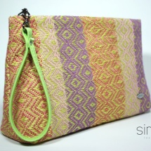 Woven purse with green handle