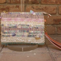Woven purse with orange leather handle