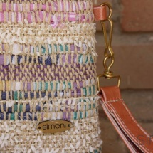 Woven purse with orange leather handle detail