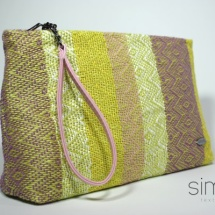 Woven purse with pink handle
