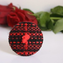 Woven red and black brooch