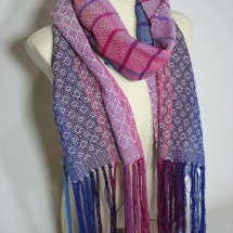 Woven shawl with patterns and stripes