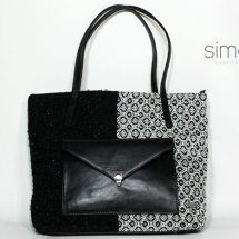 Woven shopper bag with black leather