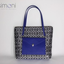 Woven shopper bag with blue leather