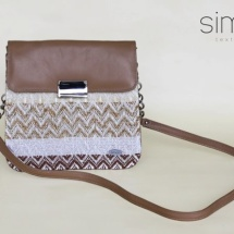 Woven shoulder bag in brown leather