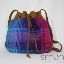Woven shoulder bag with tan leather
